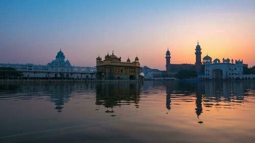 The Golden Temple at Amritsar, Punjab, India. Time lapse from dawn to sunrise