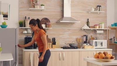 Woman Opening Efrigerator
