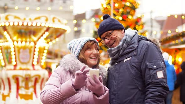 Thumbnail for Senior Couple with Smartphone at Christmas Market 1