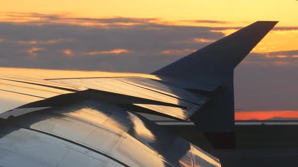 Thumbnail for Airplane Wing On Runway At Sunset