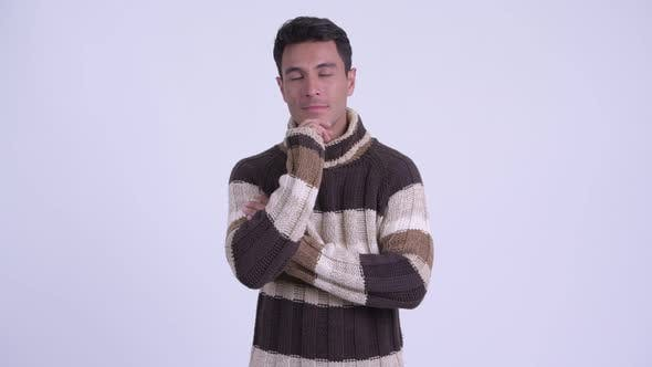 Thumbnail for Young Happy Hispanic Man Thinking Ready for Winter