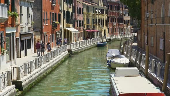 People Walking Narrow Venetian Street, Tourism and Holidays, Boats on Water