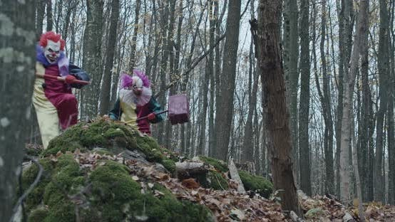 Two Scary Clowns With Hammers Run Through The Forest