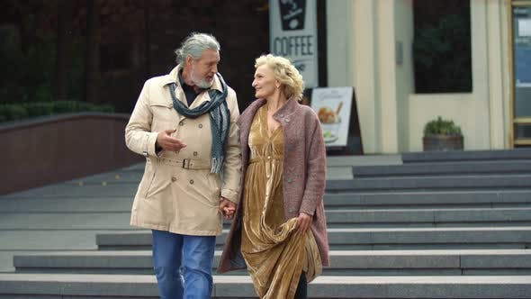 Elderly Couple Walking on the Street