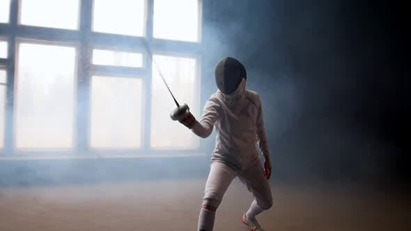 Thumbnail for A Young Woman Fencer Showing Basic Attack Movements on the Fencing