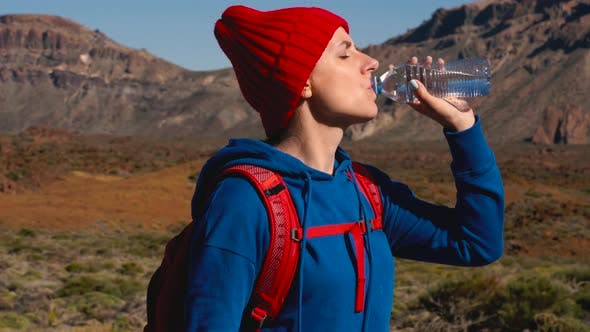 Hiking Woman Drinking Water After Hike on Teide Tenerife