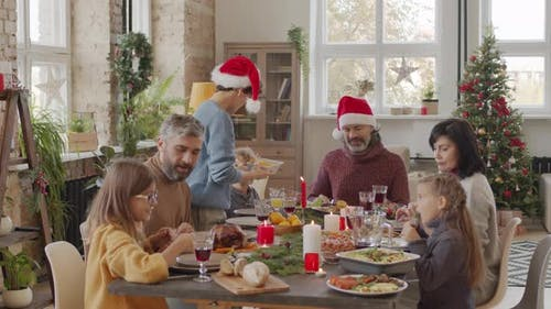 Happy Family Eating Tasty Food on Christmas