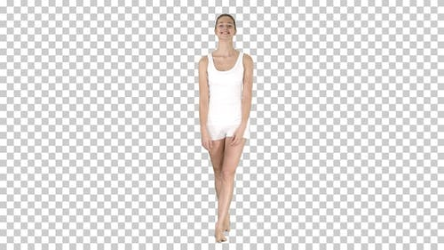 Young woman walking in white sports clothes barefoot and