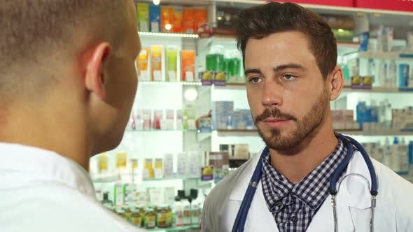 Thumbnail for Doctor Talking To Patient at Drugstore