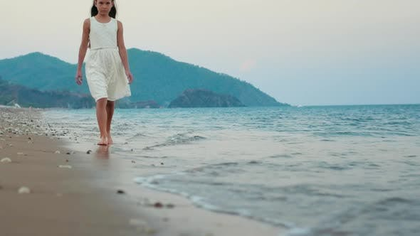 Thumbnail for Sad Girl Walk Alone at Sea Beach in Slow Motion. Thoughtful Girl Walking Alone