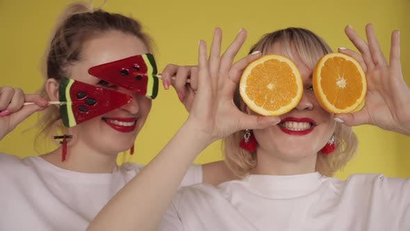Thumbnail for Happy Girls Having Party and Dancing on Yellow Background