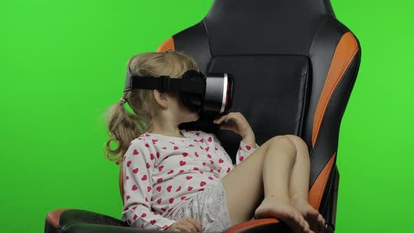 Thumbnail for Child Girl Using VR Headset Helmet To Play Game. Watching Virtual Reality 3d 360 Video. Chroma Key