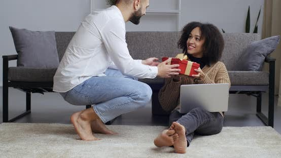 Thumbnail for Boyfriend Gives Girlfriend Present in Living Room