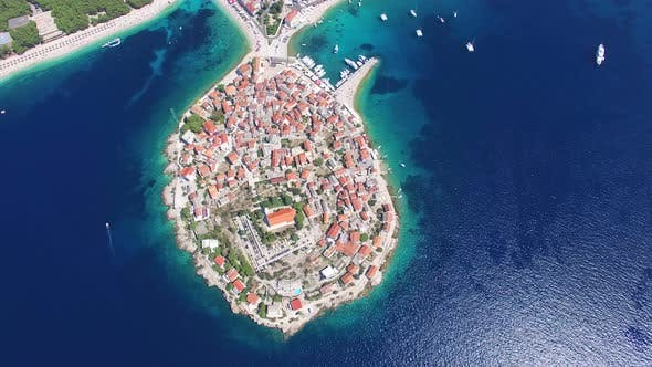 Thumbnail for Flying above traditional dalmatian houses on Primosten peninsula, Croatia