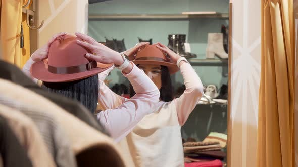 Thumbnail for Beautiful Woman Trying on a New Hat, While Shopping at Clothing Store