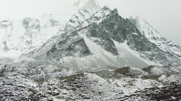 Thumbnail for Ama Dablam Mountain on Cloudy Day. Himalaya, Nepal. Aerial View