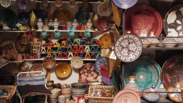 Cover Image for Traditional Moroccan Marrakech Market with Plates and Tajin Tagine. Handmade Ceramic Plates. Arabian