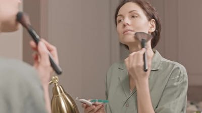 Woman Using Makeup Brush