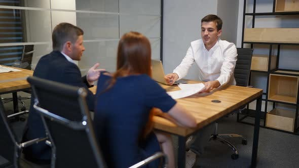 Thumbnail for Family and Realtor Businessman in Boardroom Discussing About Mortgage Contract.