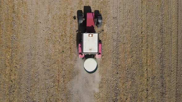 The Tractor Spreads Fertilizer To Improve The Harvest