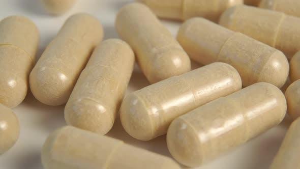 Herbal medicine capsules. Natural alternative medicine.