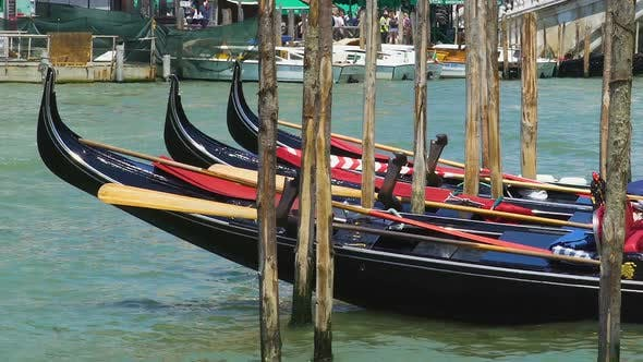 Thumbnail for Decorated Gondolas Swaying at Pier, Water Taxi in Venice as Tourist Attraction