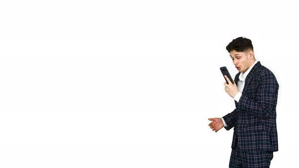Thumbnail for Inspired Man in Formal Receiving Good News on the Phone and Dancing After on White Background