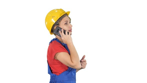 Cover Image for Beautiful young builder woman wear a yellow safety helmet