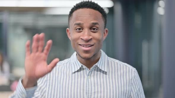 African Businessman Waving Welcoming
