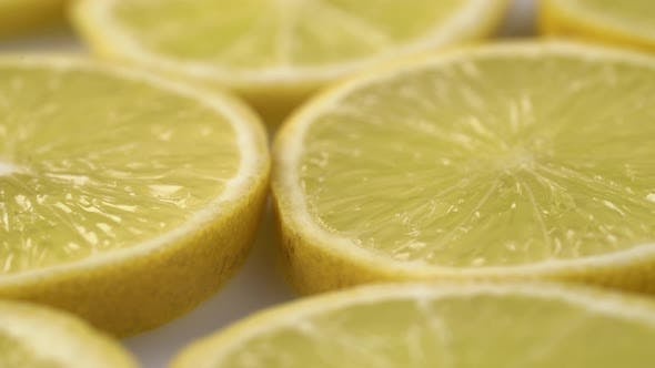 Thumbnail for Lemon Slices Closeup, Macro Food Summer Background, Fruits Top View. Rotate