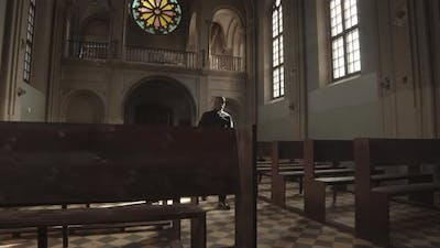 African-American Priest Going along Church