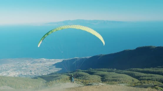 Thumbnail for Paragliding, with Pilot Adjusting Wing Controls, Changing Direction.