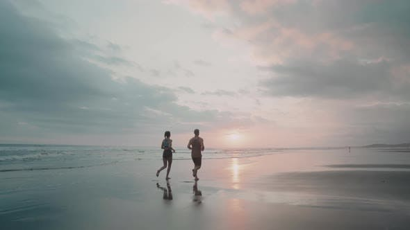 Two People Jogging at Sunset