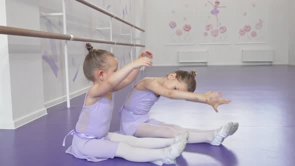 Thumbnail for Cute Little Ballerinas Stretching Together at Dancing School Together