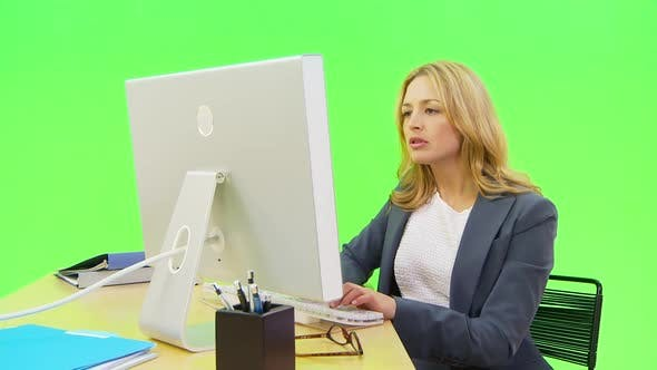 Thumbnail for Businesswoman typing at desk