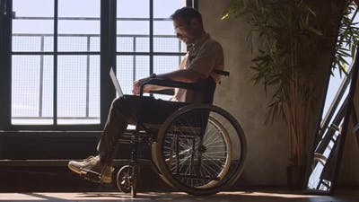 Handicapped Man by Window