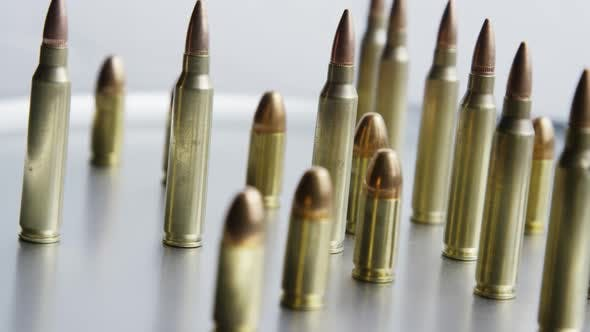 Thumbnail for Cinematic rotating shot of bullets on a metallic surface - BULLETS 077
