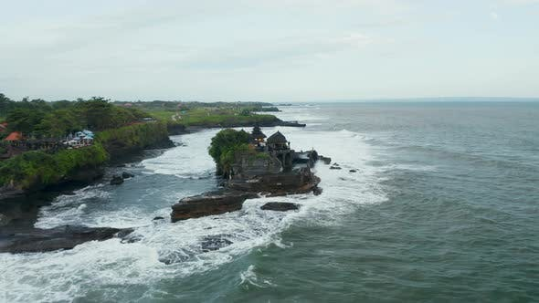 Wide Aerial Dolly Shot of Isolated Empty Tanah Lot Temple During Dangerous Weather