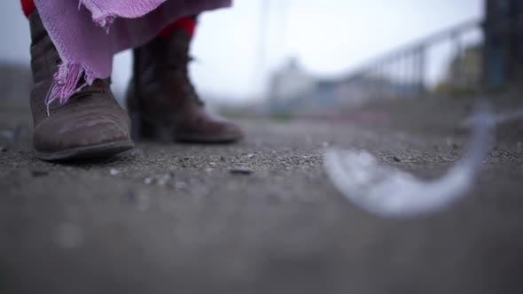Thumbnail for Close Up of a Glass Crashing on the Asphalt Next To Dirty Boots of a Homeless Person