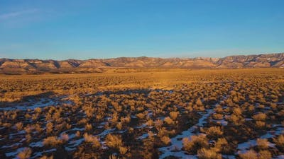 Desert and Mountains at Sunset in Winter