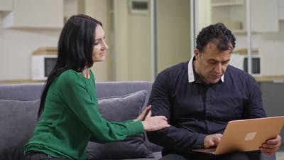 Caucasian Wife Distracting Middle Eastern Husband From Laptop