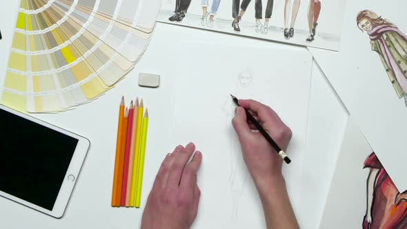 Thumbnail for Designer Creates a Sketch Using Paints for the Magazine. Close Up. Slow Motion. Time Lapse
