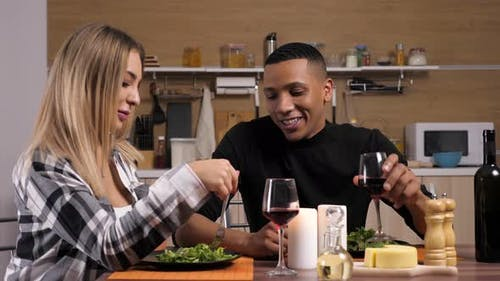 Gorgeous Interracial Couple Dinning at Candle Lights