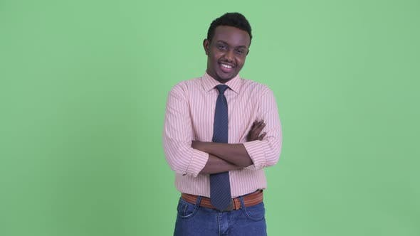 Happy Young African Businessman Smiling with Arms Crossed