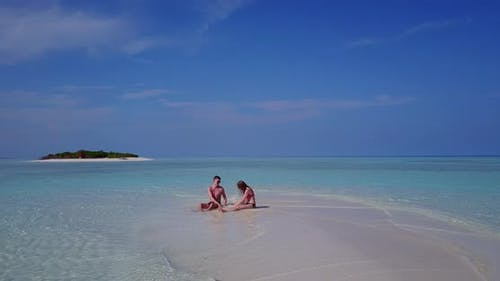 Young boy and girl on romantic honeymoon spend quality time on beach on sunny white sandy background