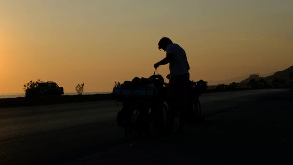 Young Man Wearing Bicycle Helmet Sunset