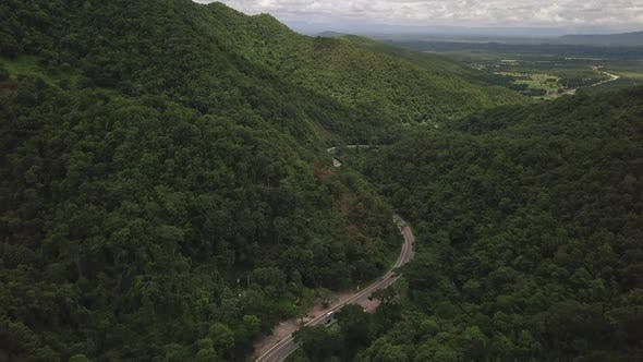 Thumbnail for Aerial View of Countryside Road passing through the Mountain Landscape 08