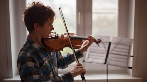 Violinist is Rehearsing Near a Window