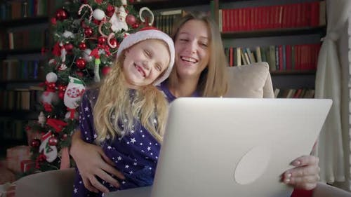 Family celebrate remote Christmas.