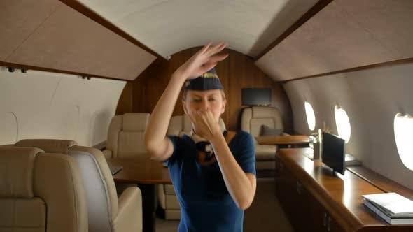 Thumbnail for Stewardess Joyfully Dancing Inside of Private Jet Cabin